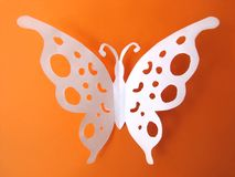Butterfly from paper on orange background Royalty Free Stock Photos