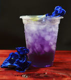 Butterfly pea drink. After adding acid Stock Photos