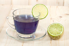 Butterfly pea flowers tea and lime Royalty Free Stock Images