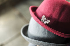 Butterfly pin on the couple silk cap Royalty Free Stock Images