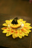 Butterfly on a platter with orange and flower Stock Photo