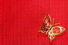 Butterfly On Red Textile Background Royalty Free Stock Photo