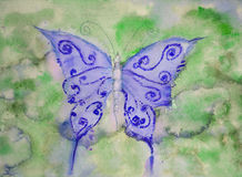 Butterfly in shades of blue against a green background. Stock Photography
