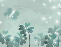 Butterfly and shamrocks. Butterfly in a bunch of shamrocks with stars or lightning bugs royalty free illustration
