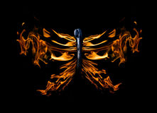 Butterfly shape flame on match isolated on black Stock Image