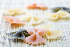 Butterfly-shaped pasta. Stock Photos