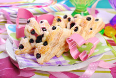 Butterfly shaped puff pastry cookies with blueberry Royalty Free Stock Photography