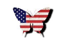 Butterfly silhouette in colors of usa national flag in grunge style isolated on white background. American flag in the form of a. Butterfly silhouette with a vector illustration