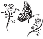Butterfly silhouette and flower branch Stock Images