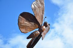 Butterfly statue in the sky royalty free stock photos