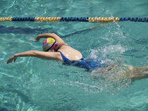 Butterfly stroke downwards. Swimming woman performing butterfly stroke with arms heading downwards Royalty Free Stock Photos