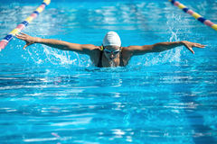 Butterfly style swimmer Royalty Free Stock Image