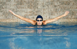 Butterfly swimming woman. In the pool Royalty Free Stock Photos