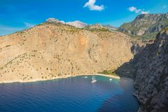 Butterfly valley sea view and boat Oludeniz,Turkey. Summer butterfly valley sea beach view and cruise boat Oludeniz,Turkey Royalty Free Stock Photos