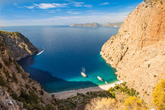 Butterfly valley sea view and boat Oludeniz,Turkey. Summer butterfly valley sea beach view and cruise boat Oludeniz,Turkey Stock Image
