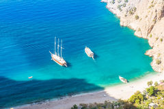 Butterfly valley sea view and boat Oludeniz,Turkey. Summer butterfly valley sea beach view and cruise boat Oludeniz,Turkey Stock Photo