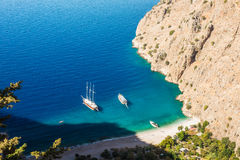 Butterfly valley sea view and boat Oludeniz,Turkey. Summer butterfly valley sea beach view and cruise boat Oludeniz,Turkey Stock Photos
