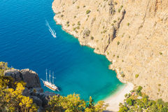 Butterfly valley sea view and boat Oludeniz,Turkey. Summer butterfly valley sea beach view and cruise boat Oludeniz,Turkey Royalty Free Stock Photo