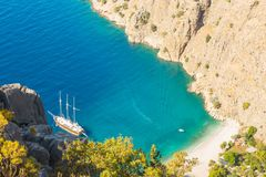 Butterfly valley sea view and boat Oludeniz,Turkey. Summer butterfly valley sea beach view and cruise boat Oludeniz,Turkey Stock Images