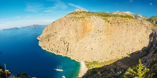 Butterfly valley sea view and boat Oludeniz,Turkey. Summer butterfly valley sea beach view and cruise boat Oludeniz,Turkey Stock Photography