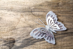Butterfly on wood Stock Images