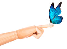 Butterfly on wooden hand. In motion Stock Photos