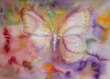 Butterfly with yellow dotted wings flying over a multicolored landscape. Royalty Free Stock Photo