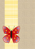 Butterfly on yellow plaid ribbon on linen background. A butterfly on yellow plaid ribbon on a beige linen texture background Stock Photo