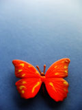 Butterfly1. Toy butterfly on blue background Royalty Free Stock Images