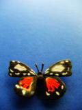 Butterfly2. Toy butterfly on blue background Stock Photo