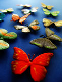 Butterfly4. Toy  butterflies on blue background Stock Photography