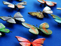 Butterfly6. Toy butterflies on blue background Stock Images