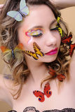 Butterfy woman. Beautiful fashion woman with professional make-up surrounded by butterflyies Royalty Free Stock Photos