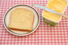 Buttering. Busy buttering a slice of bread Stock Photo