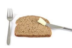 Buttering bread Stock Photography