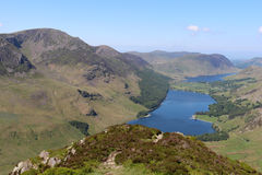 Buttermere Crummock Water Loweswater Fleetwith Pike. View from near the top of Fleetwith Pike across Buttermere and Crummock Water in the English Lake district stock photos