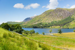 Buttermere Lake District Cumbria England uk on a beautiful sunny summer day surrounded by fells Stock Photography