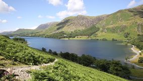 Buttermere Lake District Cumbria England uk on a beautiful sunny summer day surrounded by fells stock video