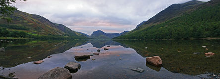 Buttermere reflections 2. Pink sky reflections on Buttermere lake in the English Lake District royalty free stock image