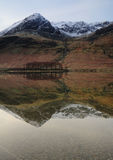 Buttermere Winter scene. Wth the mountains reflecting on the lake stock photography