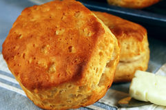 Buttermilk Biscuits. Macro of a homemade buttermilk biscuit with butter and vintage tableware Royalty Free Stock Photo