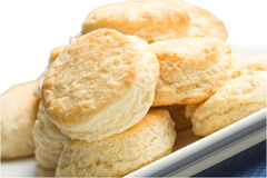 Buttermilk Biscuits. Light tasty golden homemade buttermilk biscuits arranged on rectangular platter Royalty Free Stock Photography