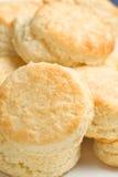 Buttermilk Biscuits. Light tasty golden homemade buttermilk biscuits arranged on rectangular platter Royalty Free Stock Images