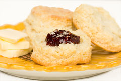 Buttermilk Biscuits. The raspberry preserves on Sunflower plate Royalty Free Stock Photos