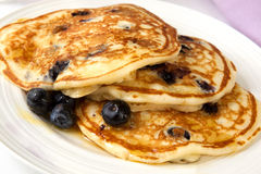 Buttermilk Blueberry Pancakes. Buttermilk pancakes with blueberries and maple syrup.  A sweet treat Royalty Free Stock Photography