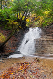 Buttermilk Falls Cascade. Buttermilk Falls, a waterfall in Ohios Cuyahoga Valley National Park, cascades down rock ledges in a forest with colorful autumn leaves Stock Photos