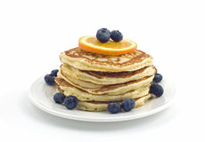 Buttermilk pancakes. With blueberries and orange slice isolated on white background Royalty Free Stock Photo
