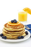 Buttermilk pancakes. With blueberries and orange slice isolated on white background Stock Photo