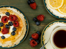 Buttermilk Pancakes With Fresh Raspberries and Blueberries. Against a Green Wooden Background Royalty Free Stock Photo