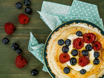 Buttermilk Pancakes With Fresh Raspberries and Blueberries. Against a Green Wooden Background Royalty Free Stock Image